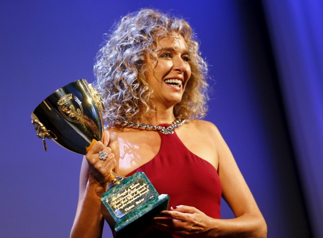 Actress Valeria Golino holds the Coppa Volpi for the Best Actress during the award ceremony at the 72nd Venice Film Festival